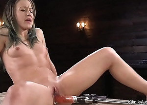 Brunette cums on fucking machine