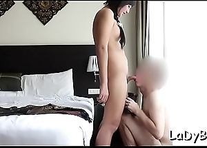 Sexy looking oriental ladyboy favors her stud with a sexy blow