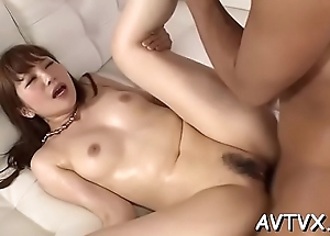 Stud is receving an venereal oral-service from cute asian