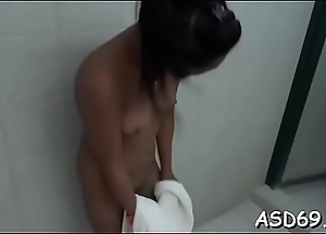 Concupiscent oriental bimbo fondles her wet cunt and gives an said job
