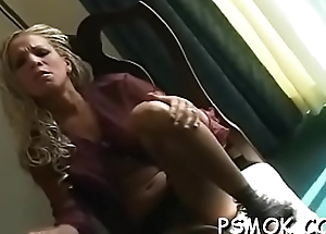 Elegant chick with reference to sexy underware loves to tease while smoking