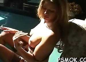 This chick gets sexually excited and masturbates whilst smoking
